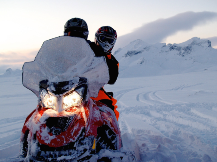 The Carter's hop on a snow mobile for a ride around Iceland.