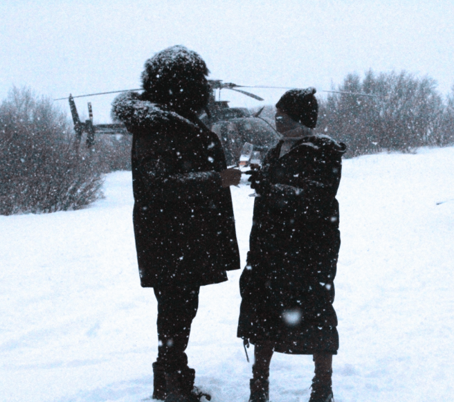 Bey and Jay share some bubbly while enjoying a beautiful snowfall.