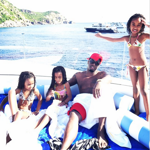 Diddy plays with his daughters in St. Barts.