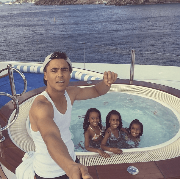 Quincy Combs hangs by the jacuzzi with the girls.