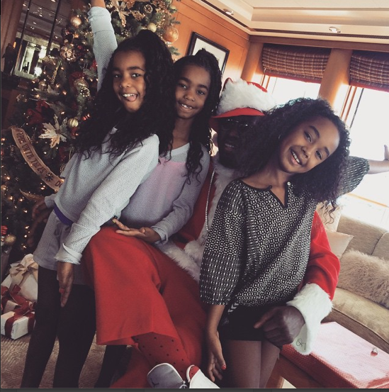 Diddy dresses as Santa Claus for his girls.