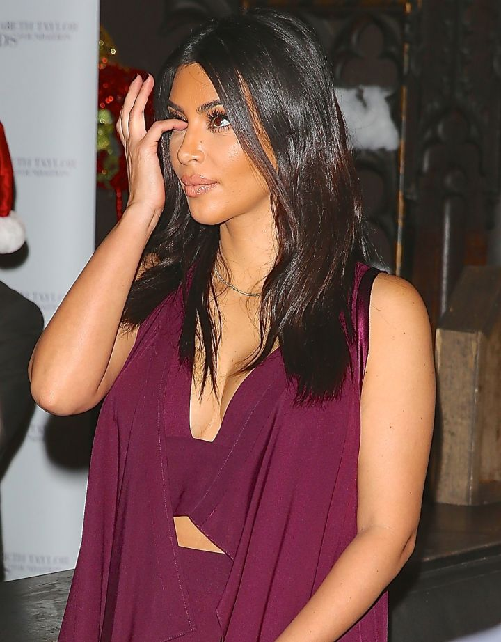 Kim Kardashian picked something out of her eye at The Club Abbey for a World AIDS Day Event.