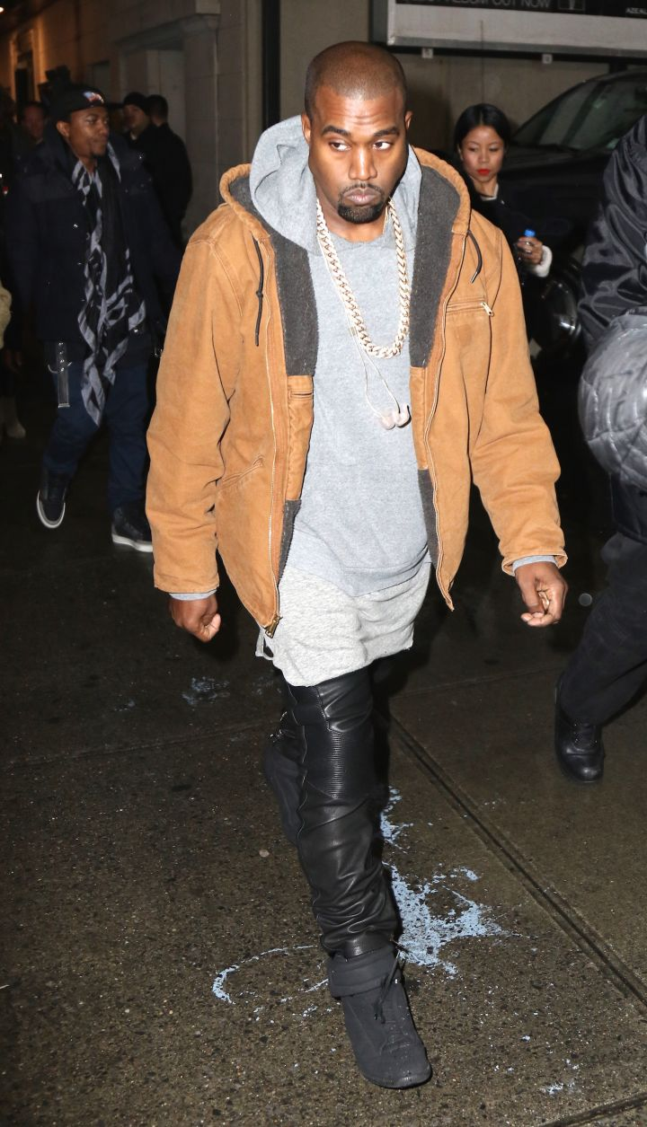 Kanye West kept it swaggy as he showed up to his Times Square performance for World AIDS Day.