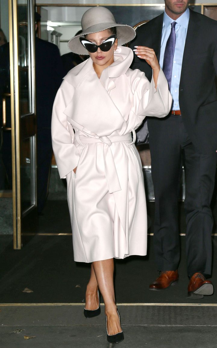 Lady Gaga was stylish while leaving her hotel in New York. What kind of outfit is under that trench coat though?