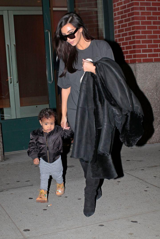Kim kickin' it with her mini-me North.