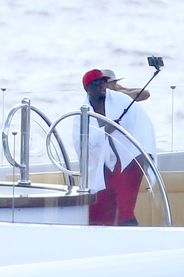 Diddy takes a selfie with the selfie stick.