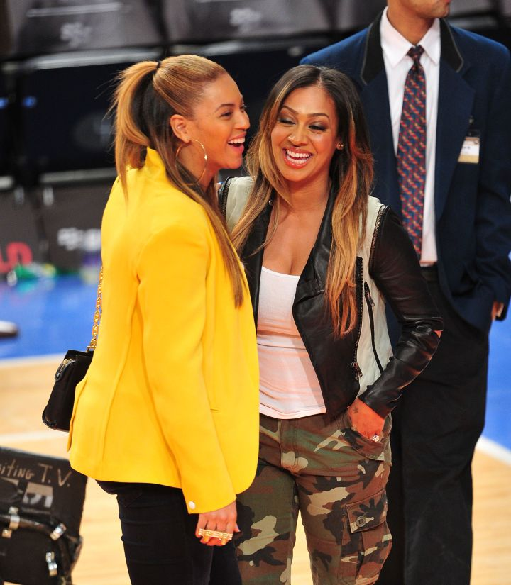 Bey and La La Anthony share a few laughs on the court.