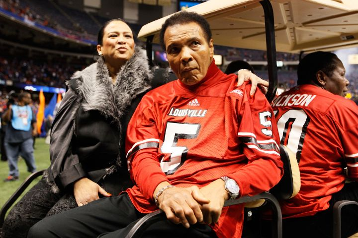 Boxing legend Muhammad Ali rides a golf cart onto the field to represent the Louisville Cardinals for the coin toss against the Florida Gators prior to the start of the Allstate Sugar Bowl at Mercedes-Benz Superdome.