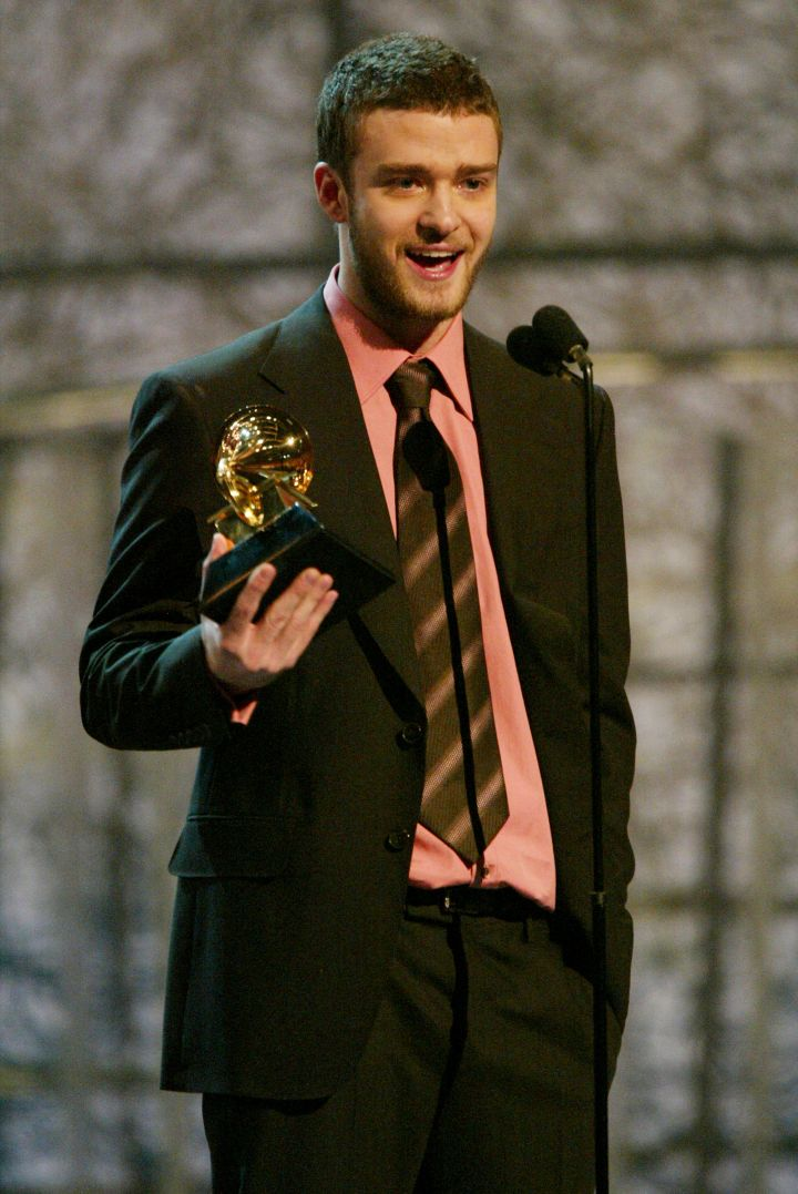 """After disbanding N'Sync and consciously uncoupling from Britney Spears, Justin released his debut album """"Justified,"""" which earned him two Grammys."""