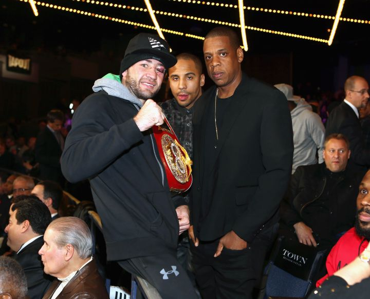 Jay Z poses with Andre Ward and a guest.