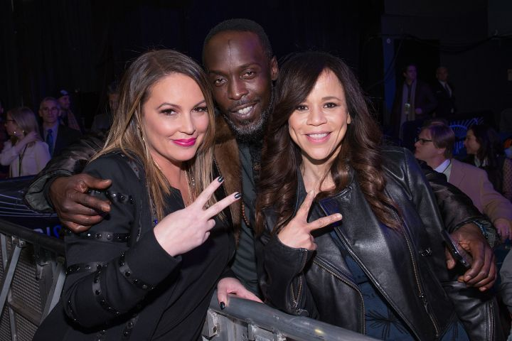 Angie Martinez and Michael K. Williams throw up the deuces.