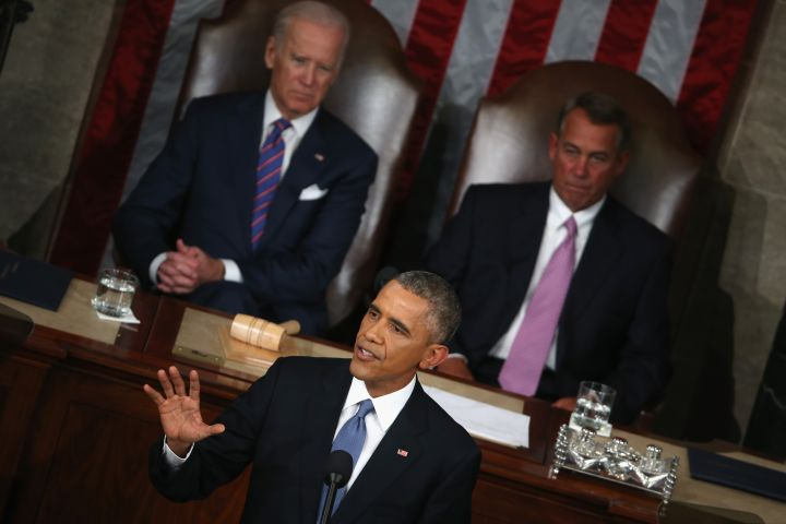 Obama begins his State of the Union speech, one of the shortest of his presidency.