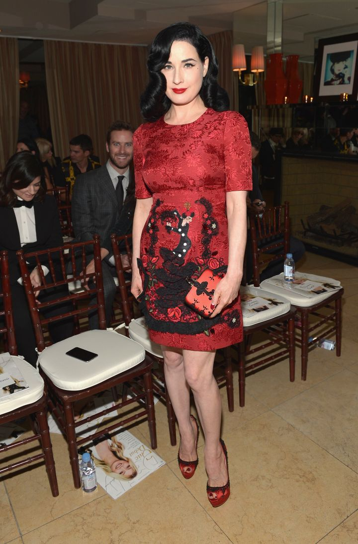 Dita Von Teese was sultry as ever in a red ensemble.