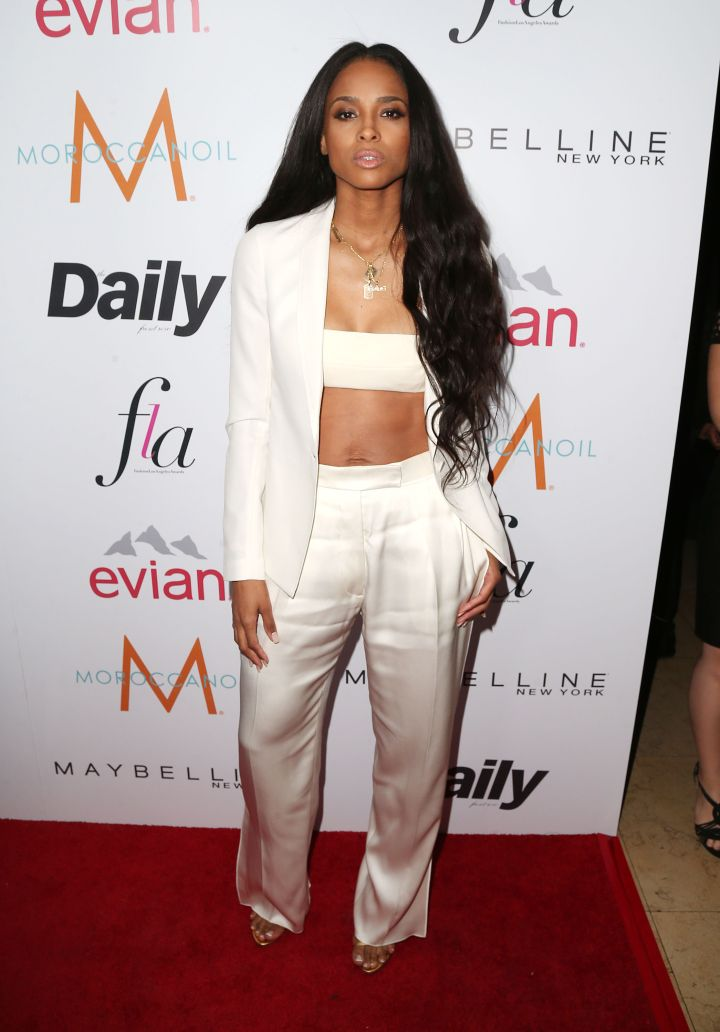 New mom Ciara showed off her ripped abs in an all-white ensemble.
