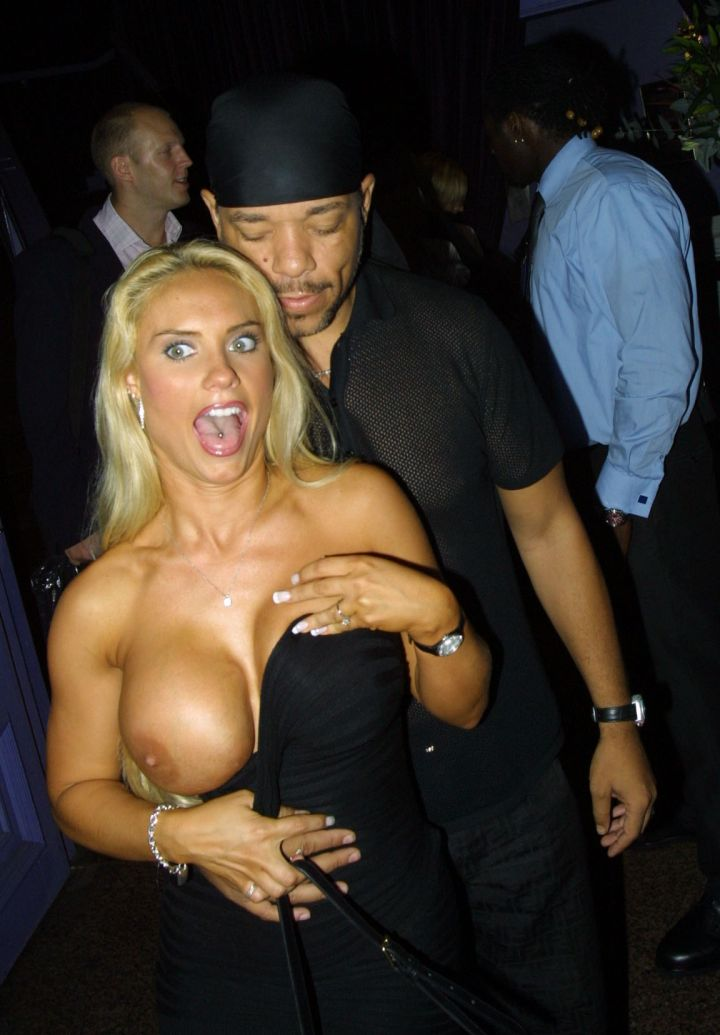 Coco shows it all as her dress slips off while hanging with her husband Ice T.