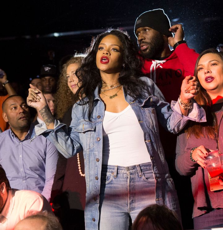 Rihanna dances while watching the main event.