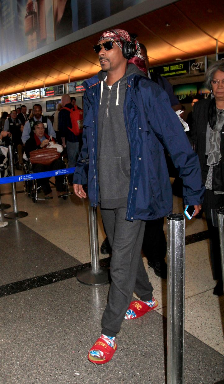 Snoop Dogg rocked an interesting outfit, complete with British flag socks, as he caught a flight out of L.A.
