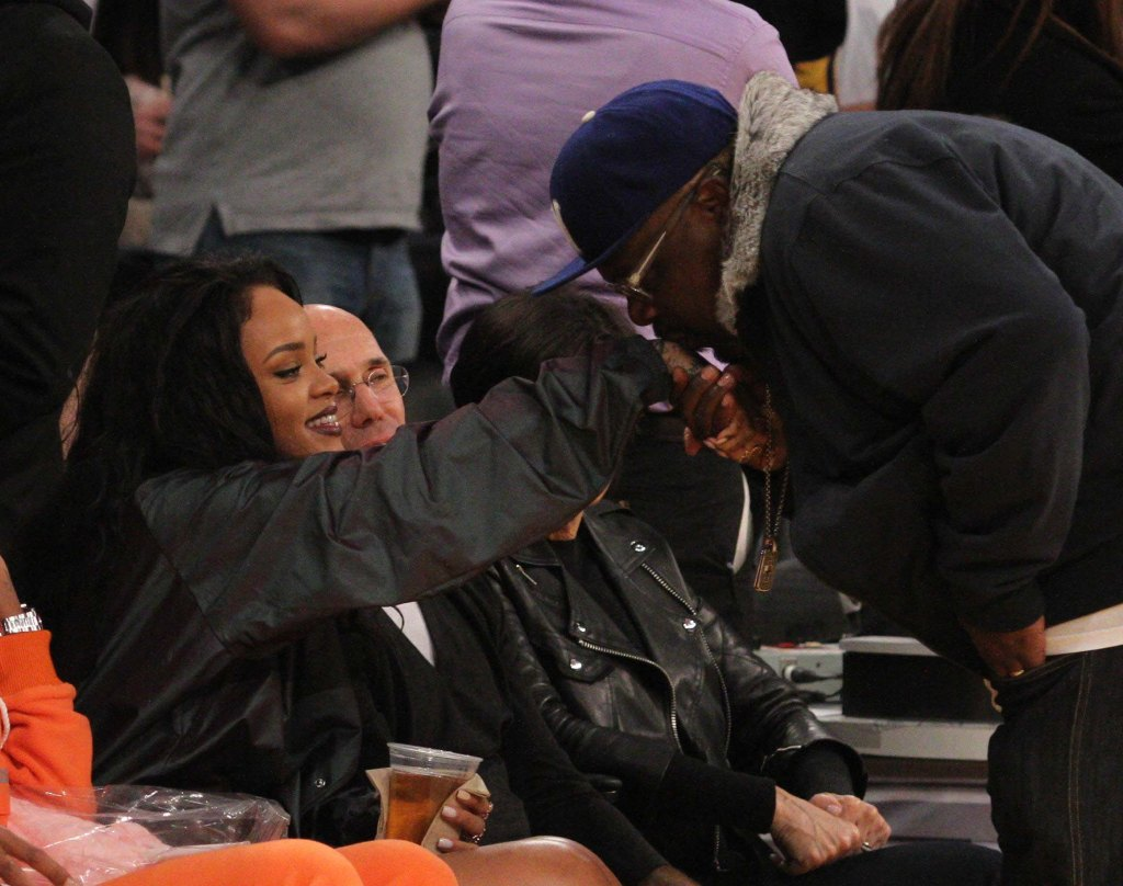 Cedric the Entertainer spotted kissing Rihanna's hand at a Basketball game in LA