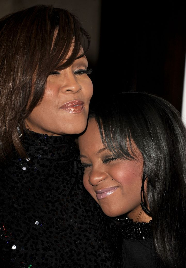 Bobbi hugs her mother at the 2011 Pre-GRAMMY Gala and Salute To Industry Icons Honoring David Geffen.