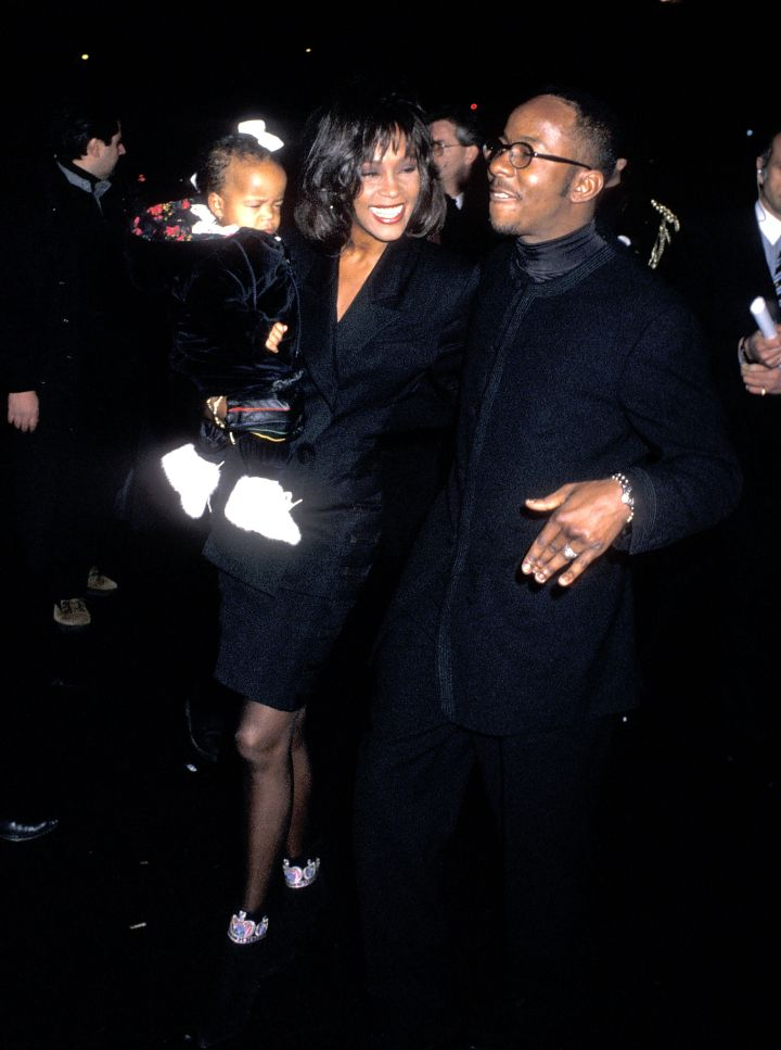 Whitney Houston, singer Bobby Brown, and daughter Bobbi Kristina Brown attend Bobby Brown's 25th Birthday Party on February 4, 1994 at Tavern on the Green.