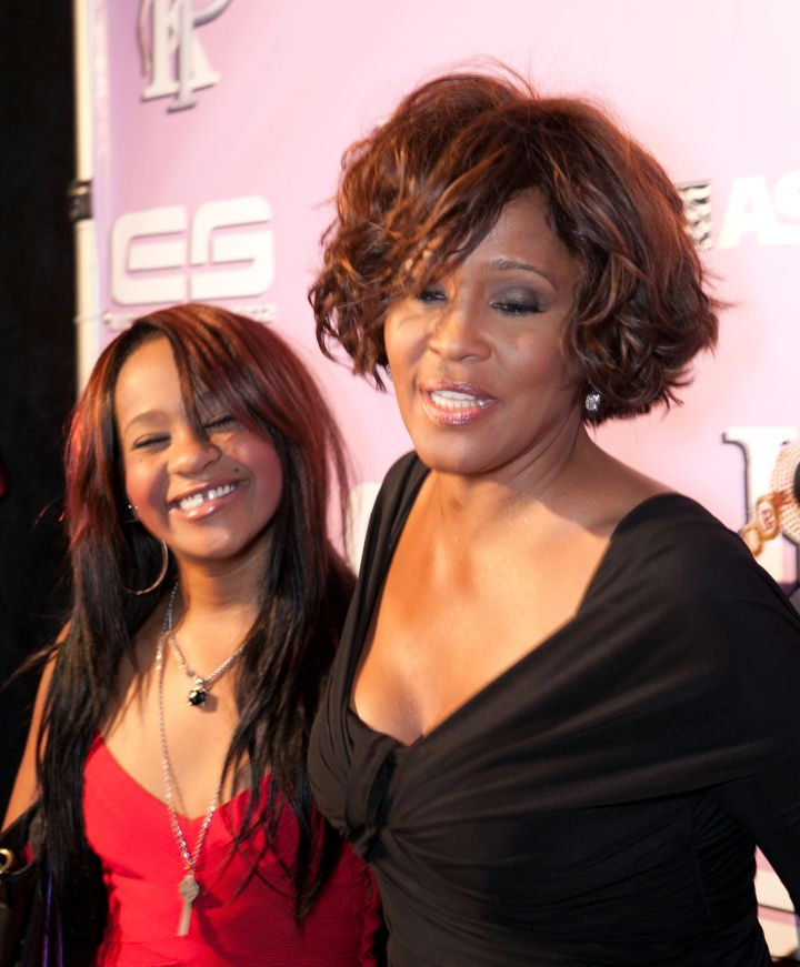 Whitney Houston and her daughter Bobbi Kristina Brown arrive at Kelly Price & Friends Unplugged: For The Love Of R&B GRAMMY Party.