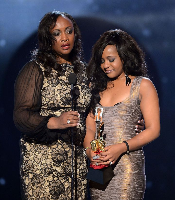 Pat Houston and Bobbi Kristina Brown accept the Millennium Award on behalf of Whitney Houston onstage at the 2012 Billboard Music Awards.