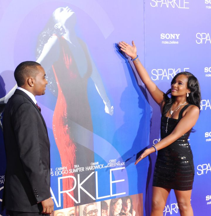 "Bobbi salutes the poster for her mother's movie during the premiere of ""Sparkle"" at Grauman's Chinese Theater in Hollywood."