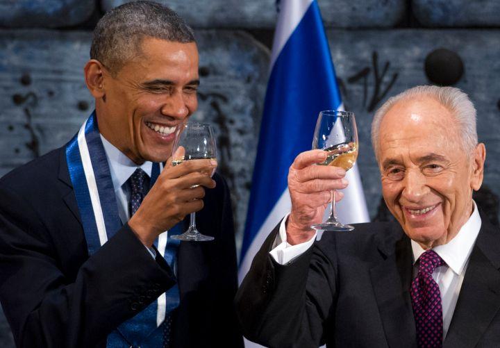 President Obama enjoys some white wine.