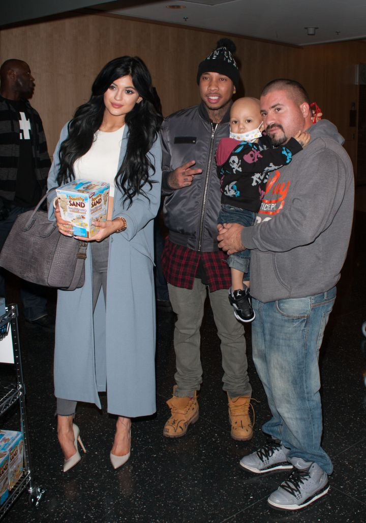 Tyga and Kylie pose with fans at a children's hospital.