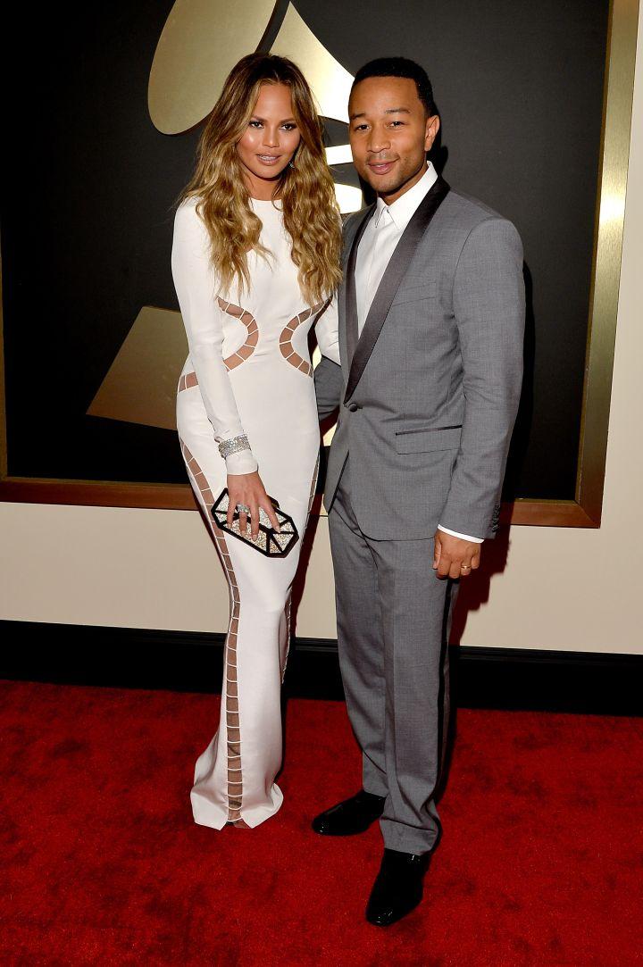 Chrissy Teigen and John Legend (in Dolce & Gabbana)