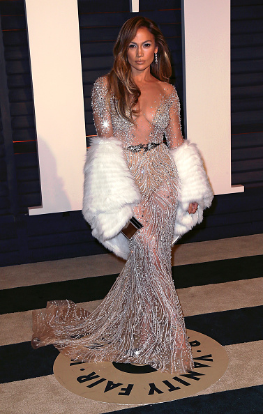J.Lo stuns in another plunge-gown at the Oscars Vanity Fair After Party in 2015.