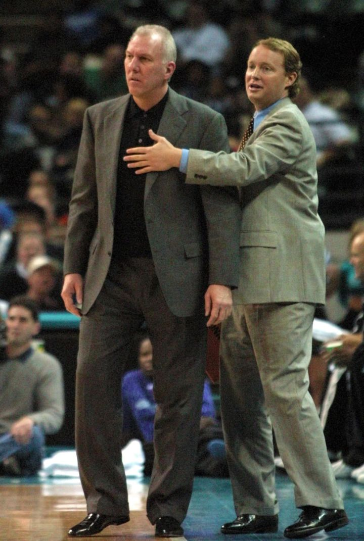San Antonio Spurs legend Gregg Popovich being restrained by this year's Eastern Conference All-Star team coach Mike Budenholzer after Pop received a technical foul, 2000.
