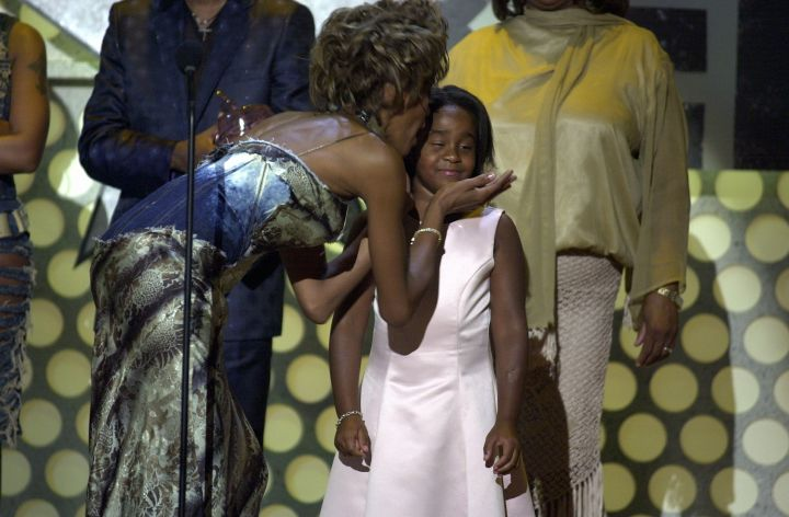 Whitney Houston kisses her daughter Bobbi Kristina Brown during the 1st Annual BET Awards on June 19, 2001.