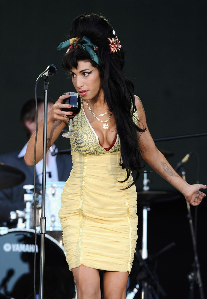 Amy Winehouse took a sip on stage.