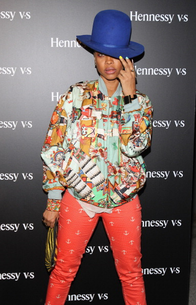 Only Erykah Badu can make a colorful windbreaker look this cool.
