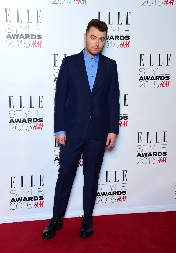 Sam Smith suited up in different hues of blue.