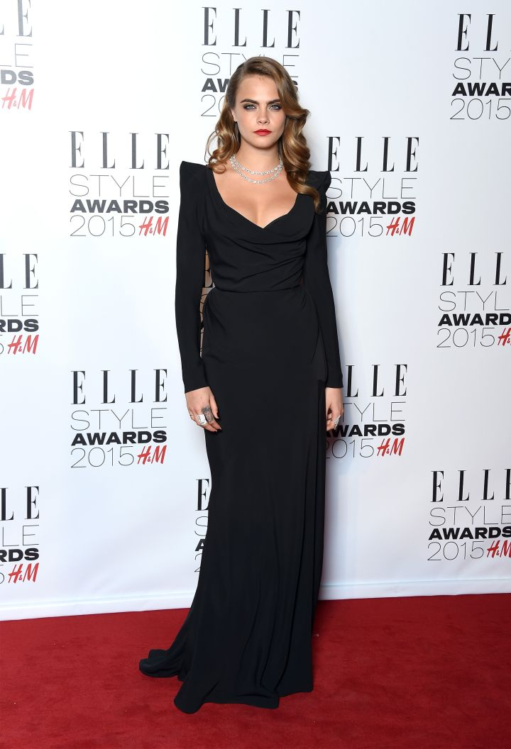 Cara Delevingne knows you can never go wrong in black with red lips.