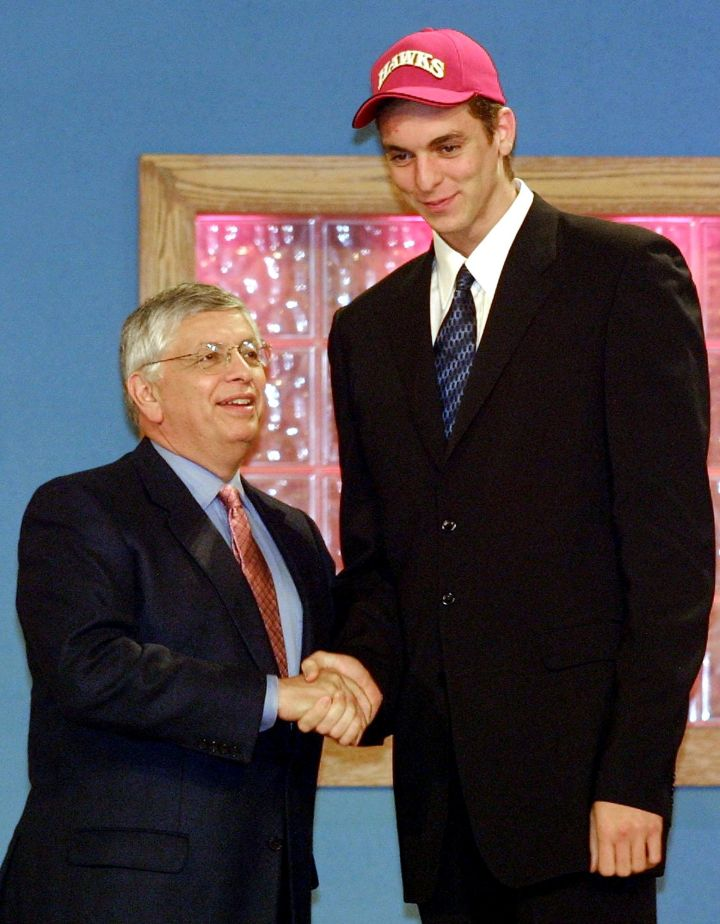 Pau Gasol congratulated by NBA Commissioner David Stern after being selected as the number three pick by the Atlanta Hawks in the 2001 NBA Draft.