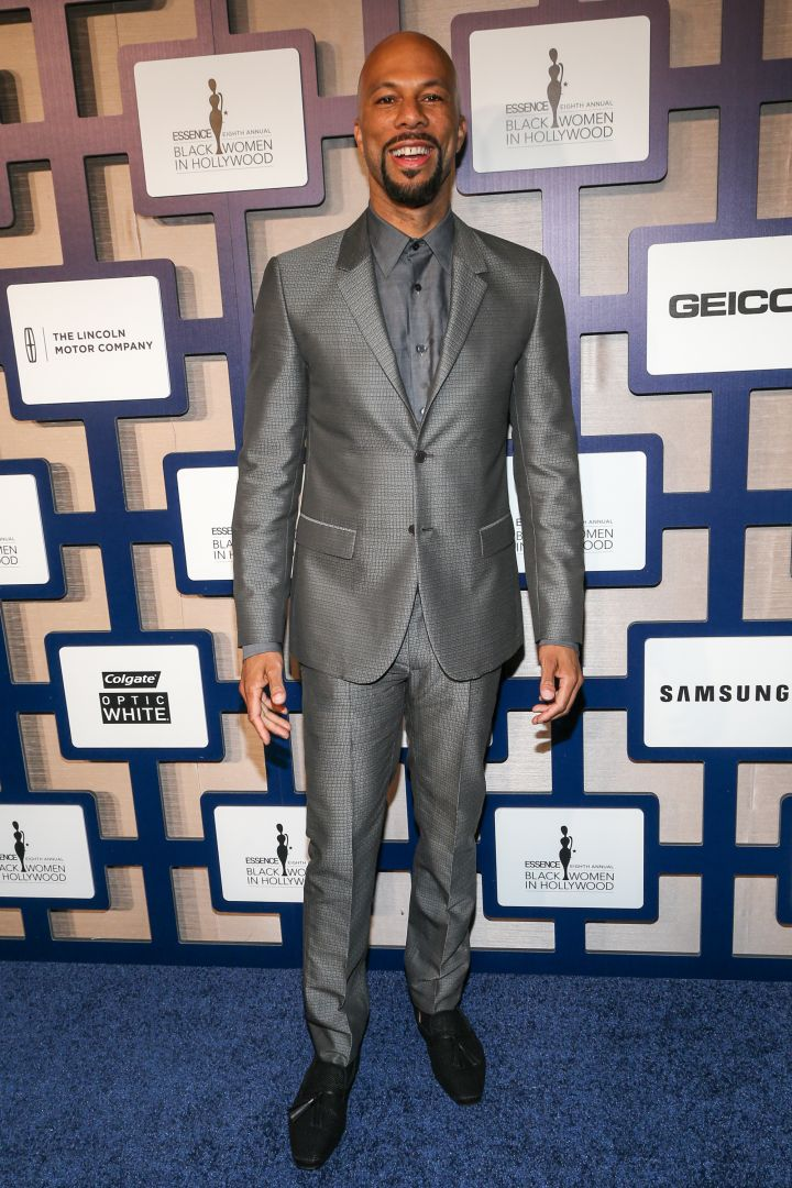 Common was dapper as usual in this metallic gray suit.