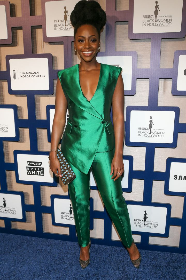 Teyonah Parris stunned in this metallic green pantsuit.