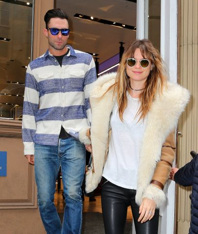 Adam Levine and wife Behati Prinsloo go shopping at the Nike store