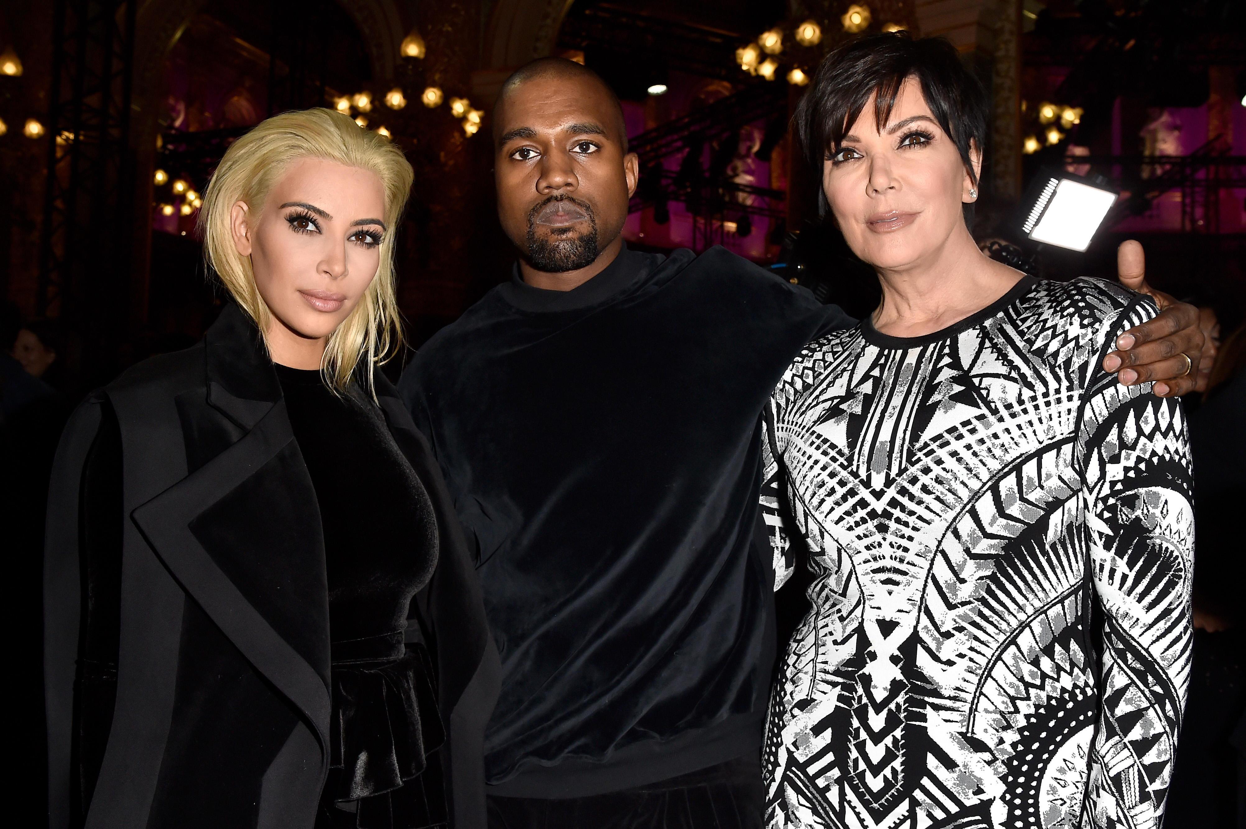 Kim Kardashian, Kris Jenner, and Kanye West attend Balmain show during Paris Fashion Week
