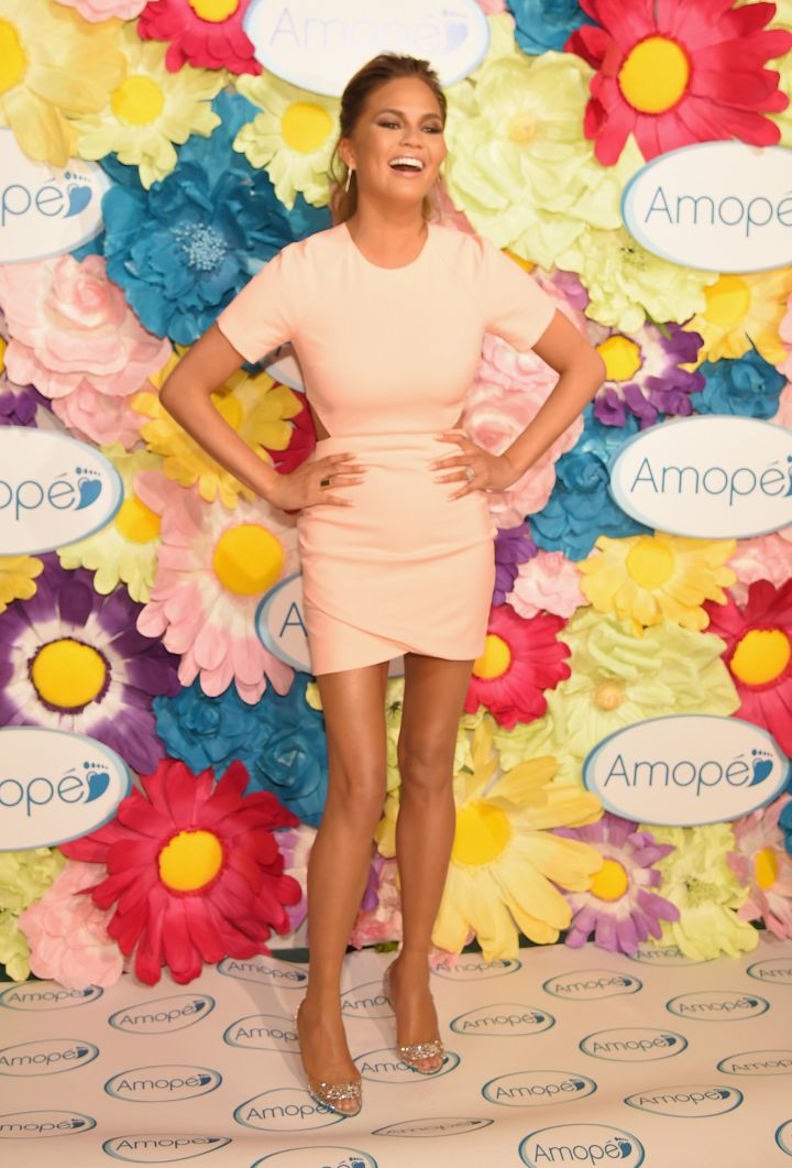 Chrissy Teigen is pretty in peach while attending the Glass-Slipper-Ready Pedicure Event in NYC.