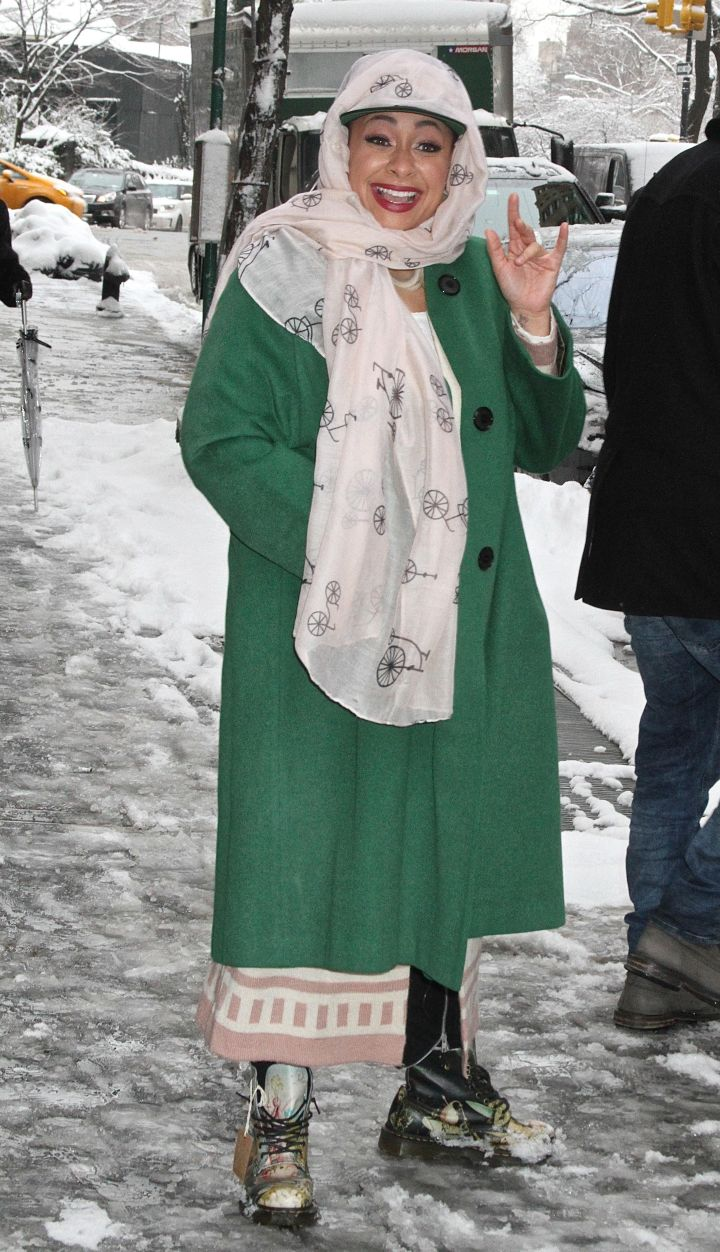 Raven Symone played no games with the wintery NYC weather as she bundled up in a green ankle-length coat, a scarf, and snow boots.
