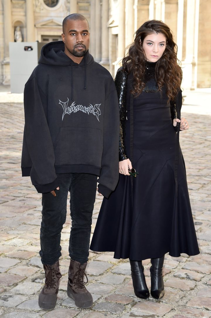 Kanye West and Lorde were matching in all black everything as they attended the Christian Dior Fashion Show in Paris. The pair looked thoroughly thrilled to be in each other's company.
