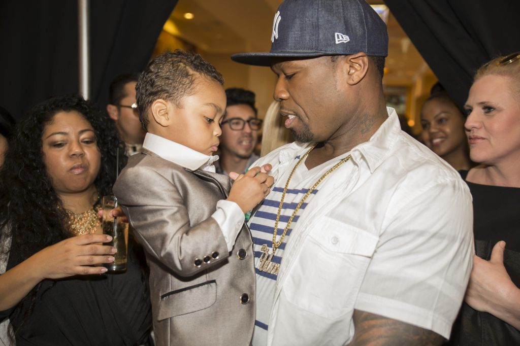 50 cent and Daphne Joy cheer on their son during LA Fashion Week