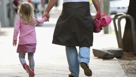 kid walking holding hands with adult