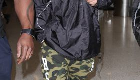 Tyga catches a flight out of LAX with his entourage