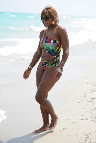 Tennis ace Serena Williams holds court at Miami beach in a colourful swimsuit