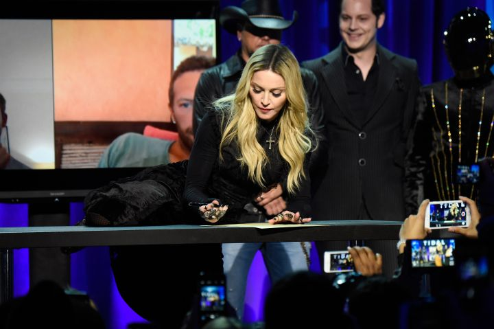 Madonna does the most Madonna thing while signing the declaration.